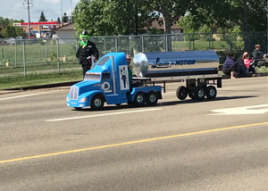 A small parade version of Liquids in Motion Ltd. bulk water hauling trick for the Leduc Black Pro Rodeo Parade.